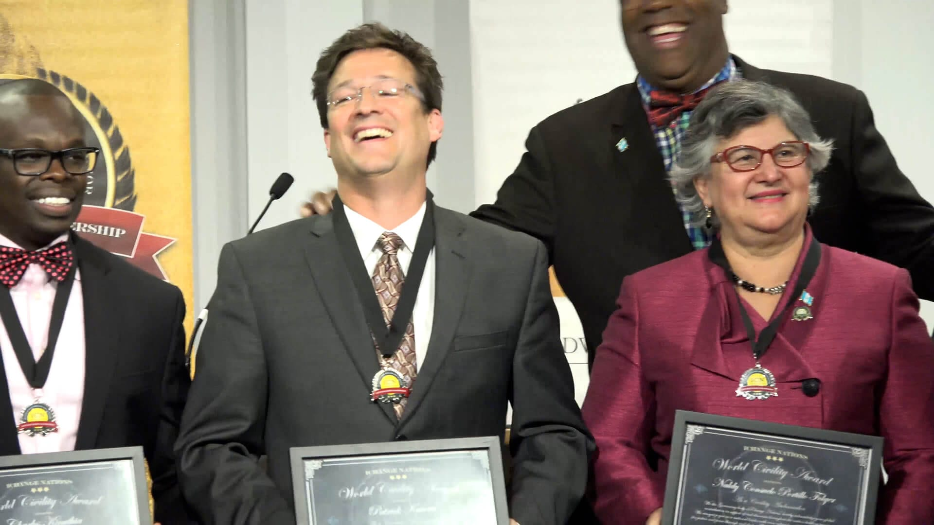 Patrick Kucera receiving the World Civility Award at iChange Nations by Dr. Clyde Rivers