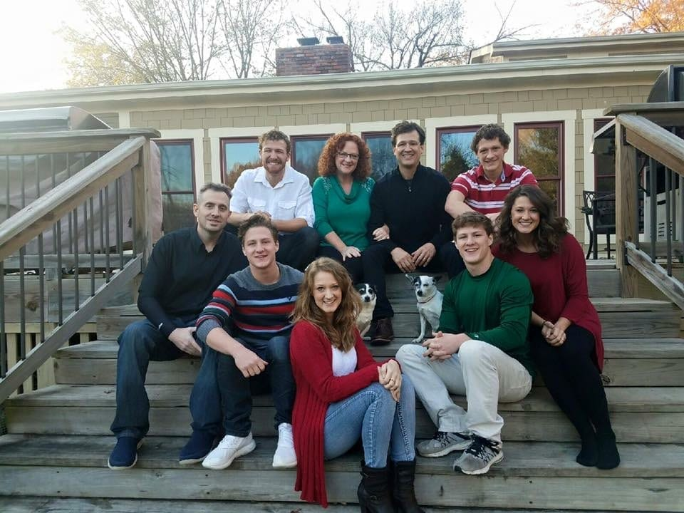 The Kucera Family sitting on the back. porch of their house 2016