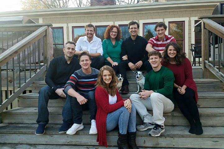 The Kucera Family sitting on the back porch of their house 2016